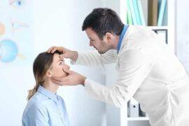 Eye Doctor examining patient